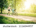 running woman with baby... | Shutterstock . vector #1116044957