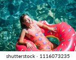 pretty woman lying on floating... | Shutterstock . vector #1116073235