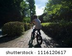 girl riding a bicycle | Shutterstock . vector #1116120617