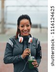 young fitness woman drinking... | Shutterstock . vector #1116124625