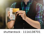 bartender with a credit card.... | Shutterstock . vector #1116138701