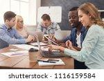 happy business partners working ... | Shutterstock . vector #1116159584