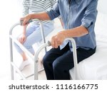 croped elderly woman hands... | Shutterstock . vector #1116166775