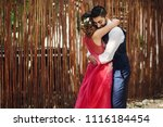 hindu newlyweds hug each other... | Shutterstock . vector #1116184454