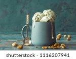 pistachio ice cream in cup on... | Shutterstock . vector #1116207941
