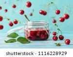 cherry jam in jar on wooden... | Shutterstock . vector #1116228929
