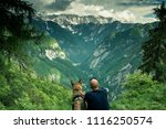 man with dog looking at view in ... | Shutterstock . vector #1116250574