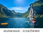 young man kayaking along the... | Shutterstock . vector #1116256364