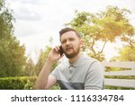casual man in a park near the... | Shutterstock . vector #1116334784