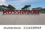 Sochi/Russia - June 11, 2018: Inscription Russia 2018 to the World Cup, in the city square on the background of palm trees and blue sky - stock photo