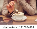 young woman's hand holding a... | Shutterstock . vector #1116376124