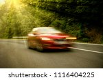 the car on the road at full... | Shutterstock . vector #1116404225