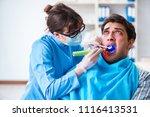 patient afraid of dentist... | Shutterstock . vector #1116413531