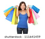 Shopper woman holding shopping bags. Young beautiful shopping woman on sale holding many colorful shopping bags isolated on white background. Pretty multiracial Asian Chinese / Caucasian female model. - stock photo