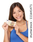 Woman showing euro money 50 bill. Multicultural girl smiling happy and fresh isolated on white background. - stock photo