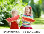 child eating watermelon in the... | Shutterstock . vector #1116426389