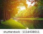 summer sunny river in the park | Shutterstock . vector #1116438011