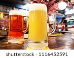 two glass of a mug of beer ... | Shutterstock . vector #1116452591