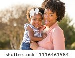 african american mother holding ...   Shutterstock . vector #1116461984