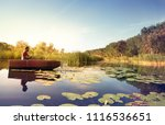 young man fishing  he sitting... | Shutterstock . vector #1116536651