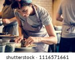 kitchen staff decorating cooked ... | Shutterstock . vector #1116571661