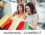 female friends with shopping... | Shutterstock . vector #1116608117