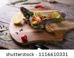 grilled dorado fish stuffed... | Shutterstock . vector #1116610331