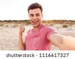 photo of handsome happy young... | Shutterstock . vector #1116617327