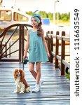 elegant child near puppy breed...   Shutterstock . vector #1116635549