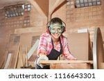 woman as craftsman cutting wood ... | Shutterstock . vector #1116643301