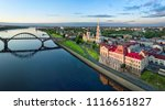 Aerial cityscape of Rybinsk: Volga river embankment, cathedral and bridge