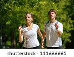young couple jogging in park at ... | Shutterstock . vector #111666665