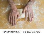 closeup hand of chef baker in... | Shutterstock . vector #1116778709