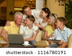 family sitting with digital... | Shutterstock . vector #1116780191
