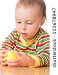 baby eating apple on a white... | Shutterstock . vector #111678947