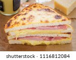 Ham cheddar cheese toastie. Bread with ham, cheese & mustard sauce & grilled cheddar and béchamel sauce topping