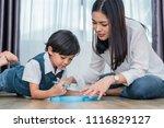 asian mom teaching cute boy to... | Shutterstock . vector #1116829127