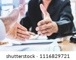 close up shake hands lawyers in ...   Shutterstock . vector #1116829721