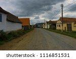 rural road at viscri in romania ...   Shutterstock . vector #1116851531