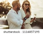 smiling man and woman enjoying... | Shutterstock . vector #1116857195