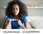 disappointed hispanic girl... | Shutterstock . vector #1116858944