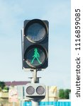 Small photo of Traffic light for pedestrians with a permission sign.