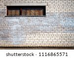 White Brick Wall With A Boarde...