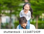 cute asian girl on neck dad big ... | Shutterstock . vector #1116871439