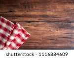 checkered red napkin on an old... | Shutterstock . vector #1116884609