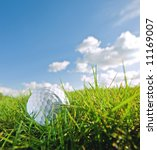 golf ball on grass of bunker with sky background - stock photo
