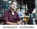 closeup of content young man... | Shutterstock . vector #1116923864