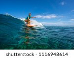 Beautiful Girl Surfing On Big...
