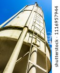 old silo tanks in front of blue ... | Shutterstock . vector #1116957944
