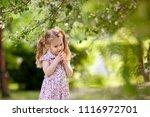 little cute girl walking in... | Shutterstock . vector #1116972701